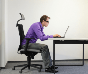 Man at computer with poor posture