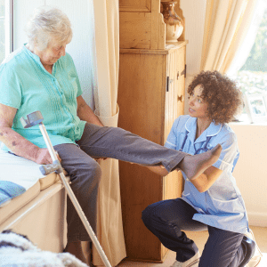 in-home physical therapist with patient